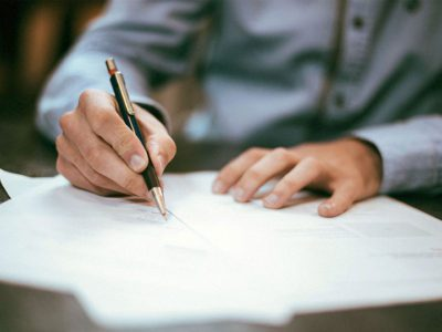 A man reviews EPLI paperwork before signing