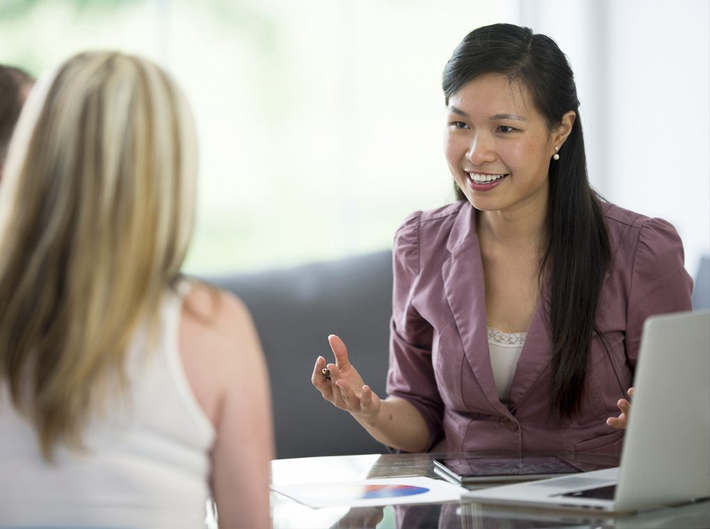 An account manager speaks with some clients